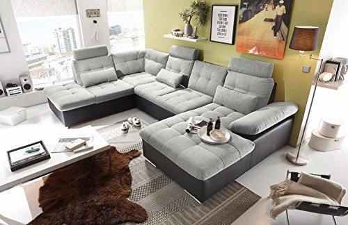 lifestyle4living Wohnlandschaft in Hellgrau und Schwarz mit verstellbaren Kopfstützen und Armteilen   Couch ist rückenecht bezogen und hat einen Bettkasten